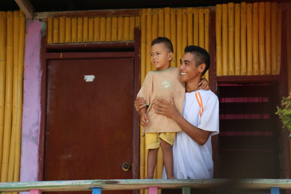 Father and son in Com, Timor-Leste.